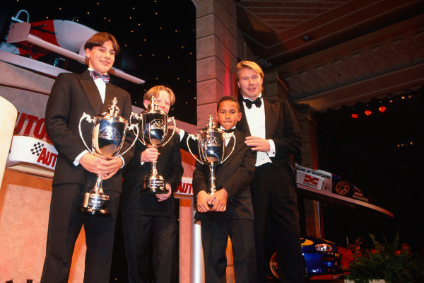 1996 Autosport Awards. Grosvenor House Hotel, London. 1st December 1996. Mika Hakkinen with the very young karters, Gary Paffett and Lewis Hamilton and Tom Sisley. World Copyright: LAT Photographic. Ref:  Colour Transparency.