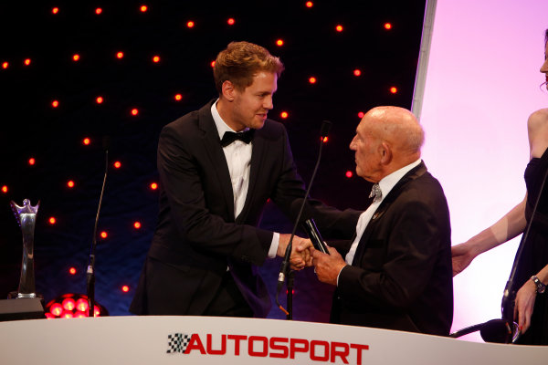 2013 Autosport Awards. Grosvenor House Hotel, Park Lane, London. Sunday 1st December 2013. Sebastian Vettel, receives International Driver of the Year Award, from Sir Stirling Moss World Copyright: Glenn Dunbar/LAT Photographic. ref: Digital Image _89P7457