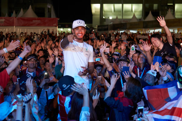 Suzuka Circuit, Japan. Saturday 7 October 2017. Lewis Hamilton, Mercedes AMG, joins a huge gathering of fans. World Copyright: Steve Etherington/LAT Images  ref: Digital Image SNE15391
