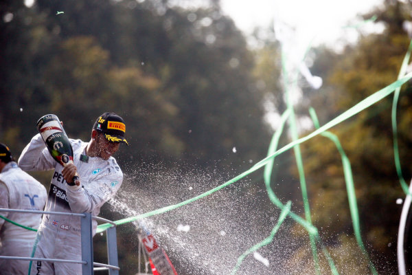 Autodromo Nazionale di Monza, Monza, Italy. Sunday 7 September 2014. Lewis Hamilton, Mercedes AMG, 1st Position, sprays Champagne from the podium. World Copyright: Steven Tee/LAT Photographic. ref: Digital Image _X0W4608