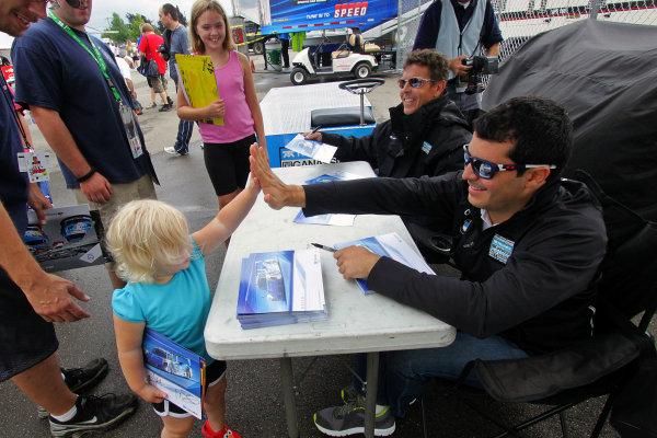 10-11 August, 2012, Watkins Glen, New York USAMemo Rojas , right, and Scott Pruett greet fans during an autograph session.(c)2012, R D. EthanLAT Photo USA