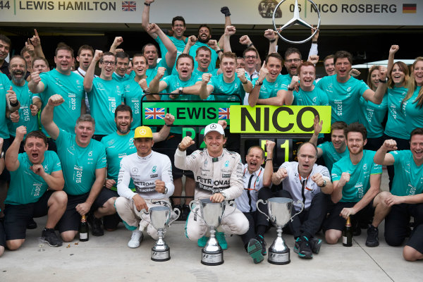 Interlagos, Sao Paulo, Brazil. Sunday 15 November 2015. Lewis Hamilton, Mercedes AMG, 2nd Position, Nico Rosberg, Mercedes AMG, 1st Position, and the Mercedes team celebrate victory. World Copyright: Steve Etherington/LAT Photographic ref: Digital Image SNE22884