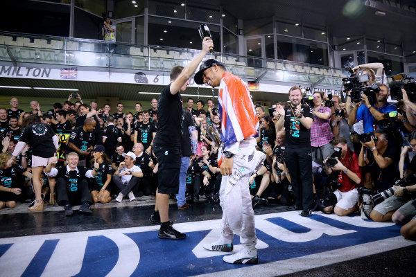 Yas Marina Circuit, Abu Dhabi, United Arab Emirates. Sunday 23 November 2014.  Lewis Hamilton and the Mercedes team celebrate championship victory.  World Copyright: Steve Etherington/LAT Photographic. ref: Digital Image SNE22558