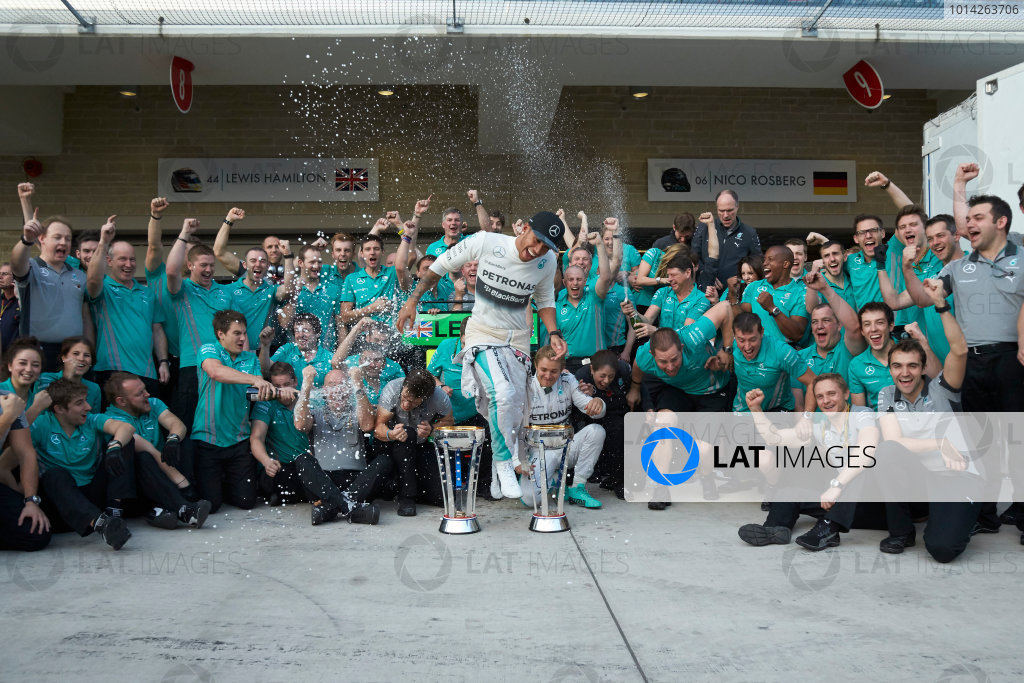 Circuit of the Americas, Austin, Texas, United States of America. Sunday 2 November 2014. Lewis Hamilton, Mercedes AMG celebrates with the team and Nico Rosberg, Mercedes AMG after winning the race. World Copyright: Steve Etherington/LAT Photographic. ref: Digital Image SNE25057