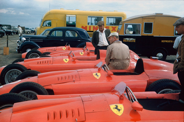 Silverstone, England. 14th July 1956. All four Lancia Ferrari D50's in the paddock, atmosphere. World Copyright: LAT Photographic Ref: 56GB01.