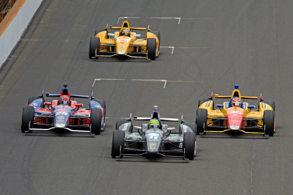 26 May, 2013, Indianapolis, Indiana, USA Eventual winner Tony Kanaan (#11) trades the lead with Marco Andretti (#25), Carlos Munoz (#26) and Ryan Hunter-Reay (#1) in the closing laps. ©2013, F. Peirce Williams LAT Photo USA