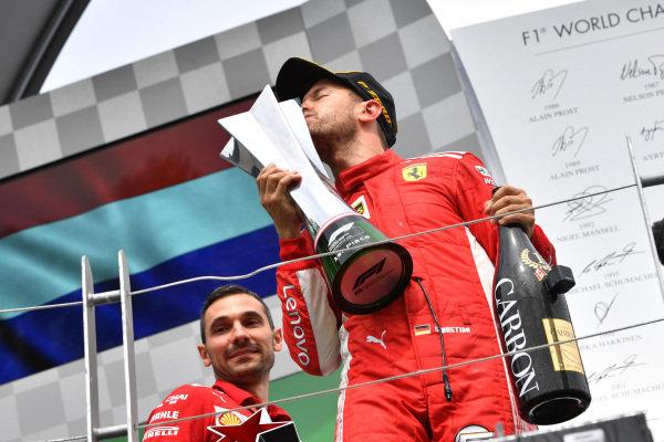 Race winner Sebastian Vettel (GER) Ferrari SF-71H celebrates on the podium and kisses the trophy