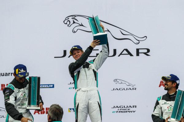 AM class victor Alice Powell (GBR), Jaguar VIP car holds her trophy aloft on the podium