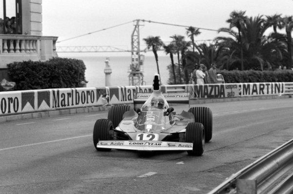 Niki Lauda, Ferrari 312T, gets sideways through Massinet.