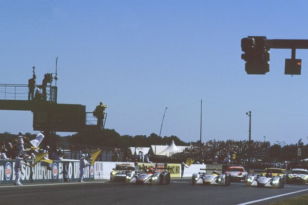 2000 Le Mans 24 Hours.Le Mans, France.17-18 June 2000.Emanuele Pirro leads his Audi R8 team-mates across the line in formation.World - Bellanca/LAT Photographic