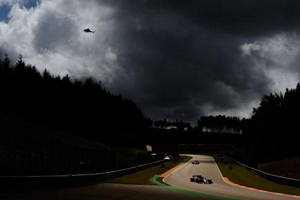 Valtteri Bottas, Mercedes F1 W11 EQ Performance, leads Max Verstappen, Red Bull Racing RB16