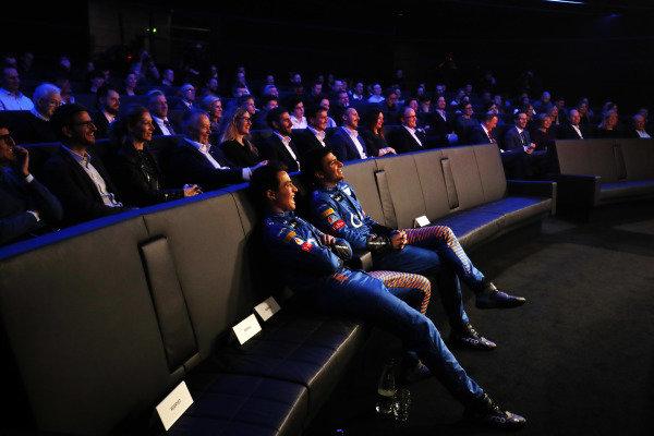 Carlos Sainz Jr, McLaren, and Lando Norris, McLaren watch the launch of the McLaren MCL35