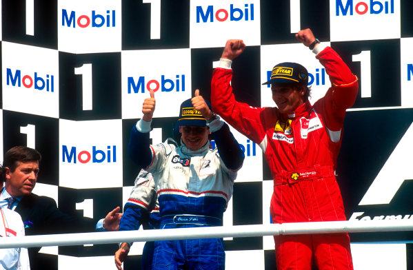 1994 German Grand Prix.Hockenheim, Germany.29-31 July 1994.Gerhard Berger (Ferrari) 1st position, Olivier Panis (Ligier Renault) 2nd position and Eric Bernard (Ligier Renault) 3rd position behind on the podium.Ref-94 GER 17.World Copyright - LAT Photographic