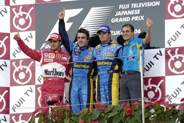 Podium group photo: Felipe Massa, 2nd position, winner Fernando Alonso, teammate Giancarlo Fisichella, 3rd position, and Renault Engine Specialist Fabrice Lom.