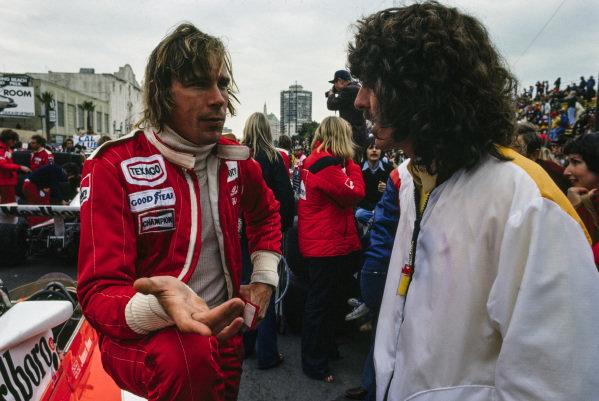 James Hunt talks to George Harrison on the grid.