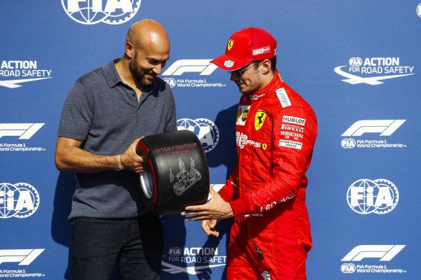 Charles Leclerc, Ferrari, celebrates pole position with the Pirelli Pole Award