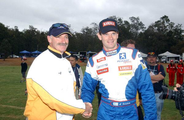 2002 World Rally Championship.Telstra Rally Australia, Perth. October 31st-November 3rd.Marcus Gronholm meets famous Australian bowler Dennis Lillee.Photo: Ralph Hardwick/LAT