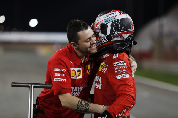 Charles Leclerc, Ferrari, celebrates after securing his maiden pole in F1
