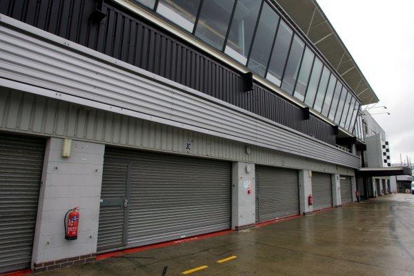 Closed garages. Formula One Testing, Silverstone, England, 21 February 2005. DIGITAL IMAGE