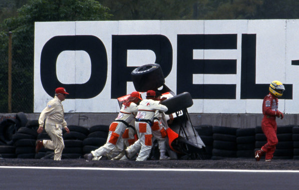 Ayrton Senna (BRA) McLaren MP4/6 rolled in Practice. As Ayrton walks away Sid Watkins (GBR) FIA Medical doctor arrives (left) Formula One World Championship, Rd6, Mexican Grand Prix, Mexico City, Mexico, 16 June 1991.