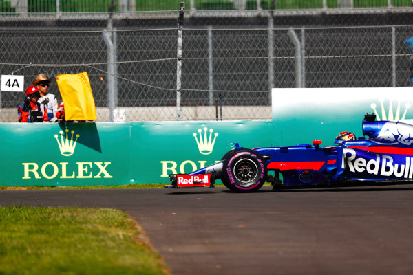 Autodromo Hermanos Rodriguez, Mexico City, Mexico. Friday 27 October 2017. Brendon Hartley, Toro Rosso STR12 Renault, stops on track in FP1, and a marshal displays a yellow flag. World Copyright: Sam Bloxham/LAT Images  ref: Digital Image _W6I9723