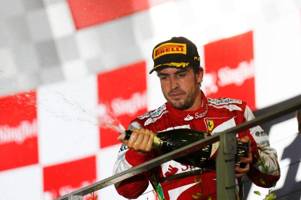 Marina Bay Circuit, Singapore. Sunday 22nd September 2013.  Fernando Alonso, Ferrari, celebrates on the podium.  World Copyright: Alastair Staley/LAT Photographic. ref: Digital Image _R6T2862