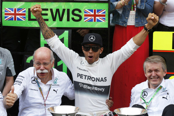Circuit de Catalunya, Barcelona, Spain. Sunday 11 May 2014. Dr Dieter Zetsche, CEO, Mercedes Benz, and Lewis Hamilton, Mercedes AMG, 1st Position, celebrate. World Copyright: Charles Coates/LAT Photographic. ref: Digital Image _N7T1345