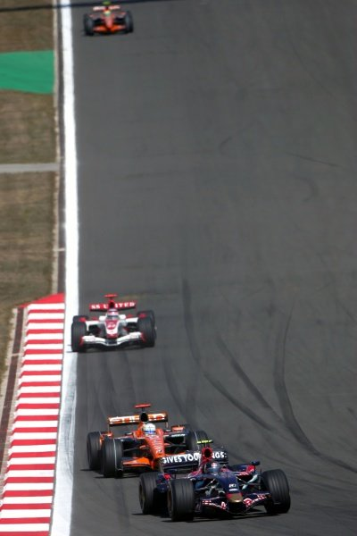 Sebastian Vettel (GER) Scuderia Toro Rosso STR02 leads Adrian Sutil (GER) Spyker F8-VII.