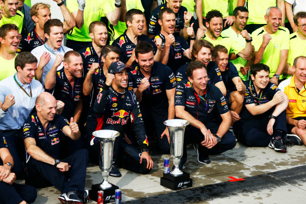 Hungaroring, Budapest, Hungary. Sunday 27 July 2014. Daniel Ricciardo, Red Bull Racing, 1st Position, and the Red Bull team celebrate victory. World Copyright: Andy Hone/LAT Photographic. ref: Digital Image _ONY2921