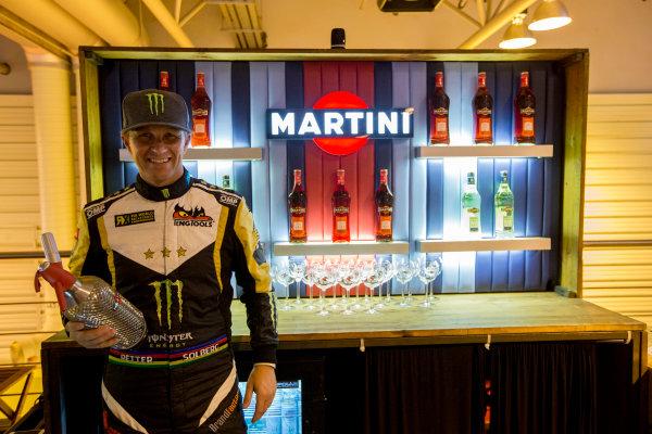 Autosport International Exhibition.  National Exhibition Centre, Birmingham, UK. Sunday 17 January 2016.  Petter Solberg learns how to mix Martini cocktails on the Williams motorhome. World Copyright: Zak Mauger/LAT Photographic. ref: Digital Image _L0U9393