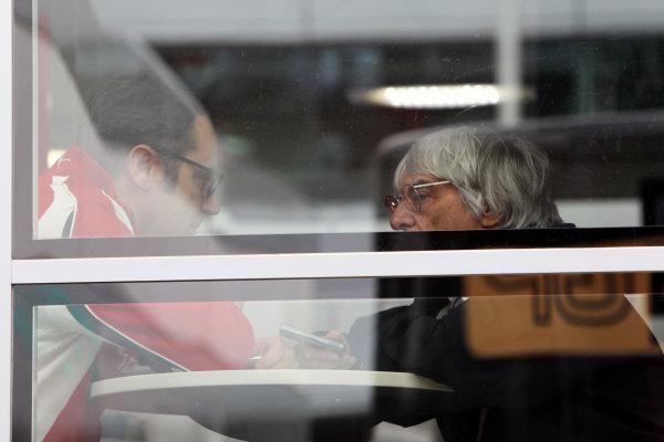 (L to R): Stefano Domenicali (ITA) Ferrari General Director with Bernie Ecclestone (GBR) CEO Formula One Group (FOM). Formula One World Championship, Rd 9, British Grand Prix, Qualifying Day, Silverstone, England, Saturday 9 July 2011.