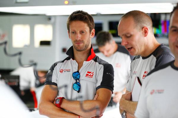 Hockenheim, Germany. Thursday 28 July 2016. Romain Grosjean, Haas F1, with team colleagues. World Copyright: Andy Hone/LAT Photographic ref: Digital Image _ONZ4826