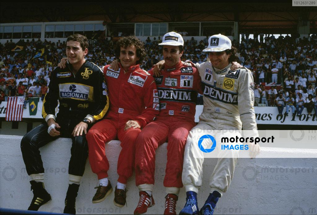 Estoril, Portugal.19-21 September 1986.(L-R) Championship contenders Ayrton Senna (Team Lotus), Alain Prost (McLaren TAG Porsche), Nigel Mansell and Nelson Piquet (both Williams Honda).Ref-86 POR 11.World Copyright - LAT Photographic