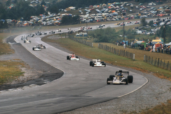 1973 Canadian Grand Prix.  Mosport Park, Ontario, Canada. 21st-23rd September 1973.  Ronnie Peterson, Lotus 72E Ford, leads from Jody Scheckter, McLaren M23 Ford, and Niki Lauda, BRM P160E, at the start.  Ref: 73CAN24. World copyright: LAT Photographic