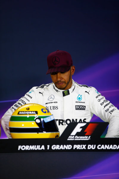 Circuit Gilles Villeneuve, Montreal, Canada. Saturday 10 June 2017. The post-qualifying press conference: Lewis Hamilton, Mercedes AMG, shows off his Ayrton Senna helmet, a gift after equalling the Brazilian's pole record.  World Copyright: Andy Hone/LAT Images ref: Digital Image _ONY4912