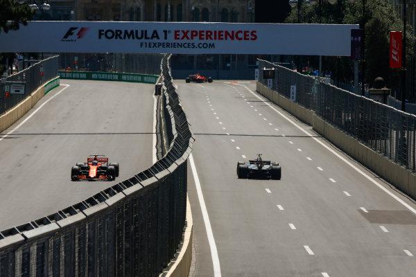 Baku City Circuit, Baku, Azerbaijan. Friday 23 June 2017. Fernando Alonso, McLaren MCL32 Honda, and Romain Grosjean, Haas VF-17. World Copyright: Andrew Hone/LAT Images ref: Digital Image _ONY8613