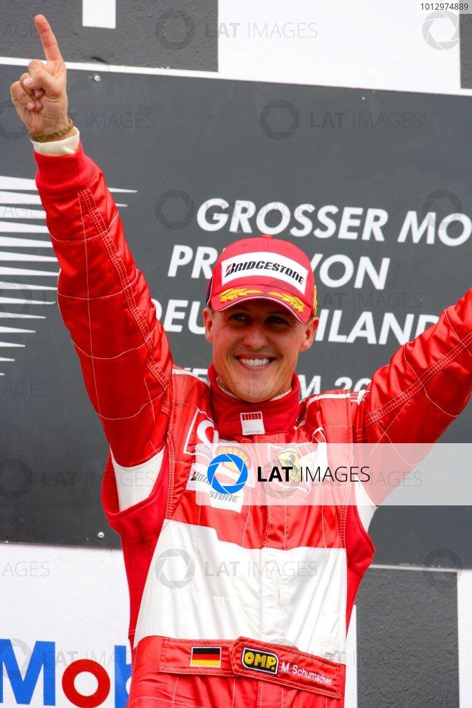 2006 German Grand Prix - Sunday Race Hockenheim, Germany. 27th - 30th July. Michael Schumacher, Ferrari 248F1, 1st position, celebrates his 89th win and 70th for Ferrari, podium. World Copyright: Lorenzo Bellanca/LAT Photographic ref: Digital Image ZD2J2119