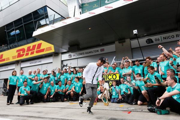 Red Bull Ring, Spielberg, Austria. Sunday 21 June 2015. Nico Rosberg, Mercedes AMG, 1st Position, and Lewis Hamilton, Mercedes AMG, 2nd Position, celebrate with their team. World Copyright: Alastair Staley/LAT Photographic. ref: Digital Image _R6T7250