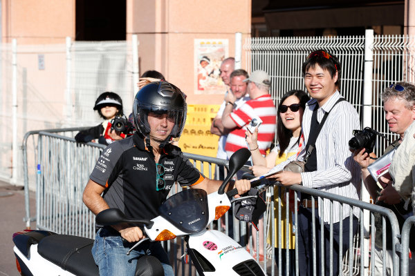 Monte Carlo, Monaco. Wednesday 20 May 2015. Sergio Perez, Force India, signs autographs for fans. World Copyright: Charles Coates/LAT Photographic. ref: Digital Image _N7T0868