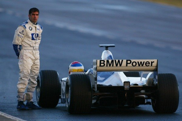 Marc Gene (ESP) Williams Test Driver stands beside his stricken Williams.