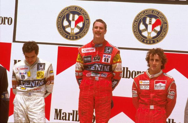 Paul Ricard, Le Castellet, France.3-5 July 1987.Nigel Mansell (Williams Honda) 1st position, Nelson Piquet (Williams Honda) 2nd position and Alain Prost (McLaren TAG Porsche) 3rd position on the podium.Ref-87 FRA 07.World Copyright - LAT Photographic