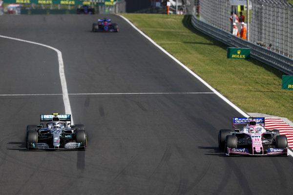 Valtteri Bottas, Mercedes AMG W10, battles with Sergio Perez, Racing Point RP19