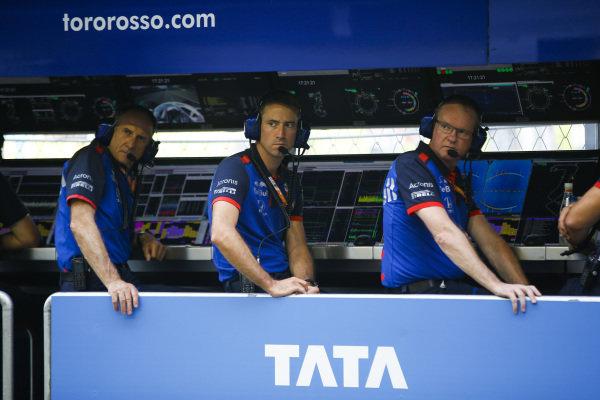 Franz Tost, Scuderia Toro Rosso Team Principal, on the pit wall.