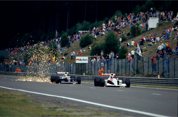 2003 Racing Past. . Exhibition1992 Belgian Grand Prix, Spa-Francorchamps. Nigel Mansell prepares to overtake Gerhard Berger.World Copyright - LAT PhotographicExhibition ref: a094