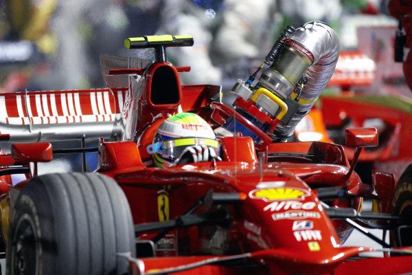 Felipe Massa, Ferrari F2008 leaves his pit box with the fuel hose still attached.