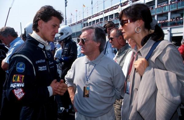 Michael Schumacher (GER) Mercedes (left) meets F1 supremo Bernie Ecclestone (centre). Sportscar World Championship, Magny-Cours, France, 15 September 1991.