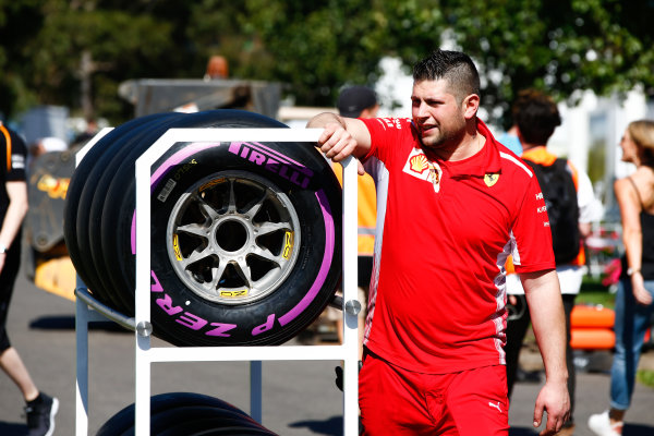 Ferrari engineer with the Pirelli Hypersoft tyres in the paddock.