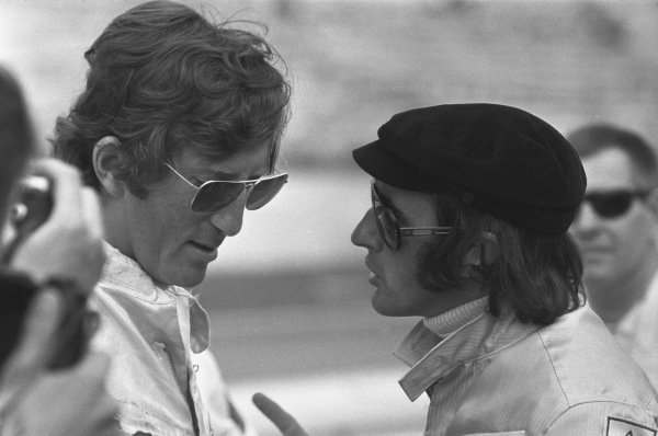 1970 German Grand Prix. Hockenheim, Germany. 31st July - 2nd August 1970. Jochen Rindt (Lotus 72C-Ford), 1st position, in conversation with Jackie Stewart (March 701-Ford), retired, portrait.  World Copyright: LAT Photographic. Ref: 1324D - 8A.