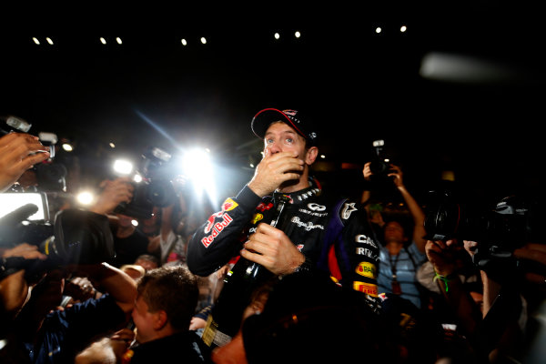 Buddh International Circuit, New Delhi, India. Sunday 27th October 2013. Sebastian Vettel, Red Bull Racing, 1st position, and the Red Bull team celebrate winning the drivers and constructors titles. World Copyright: Alastair Staley/LAT Photographic. ref: Digital Image _R6T9412