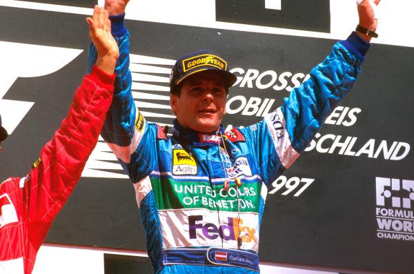Hockenheim, Germany.25-27 July 1997.Gerhard Berger (Benetton Renault) celebrates 1st position on the podium. His last Grand Prix win.Ref-97 GER 01.World Copyright - LAT Photographic